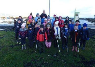 Children from Carnalbanagh Primary School with Billy McCauley, Harbour Master at Glenarm Marina where they carried out a litter pick earlier this year.