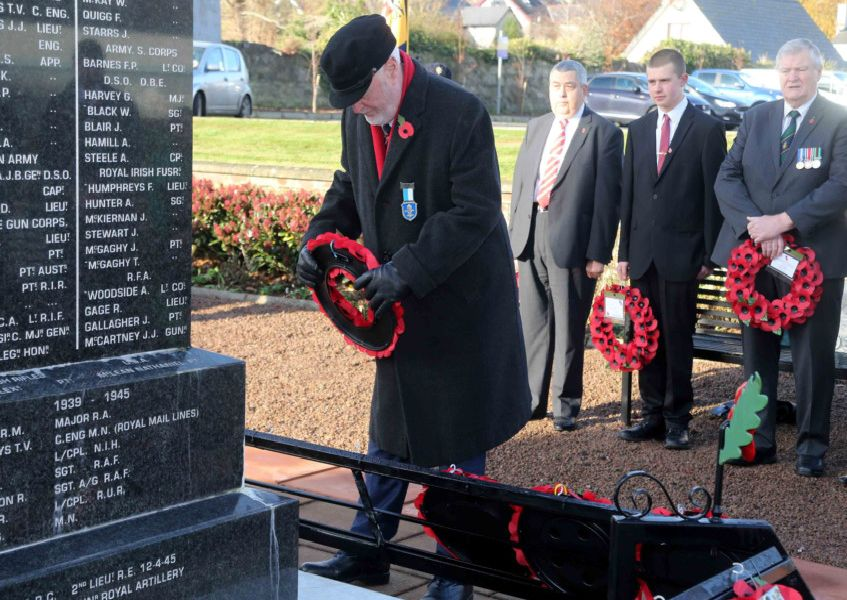 Chris McCaughan lays a wreath on behalf of the Marconi Radio Group at Ballycastle