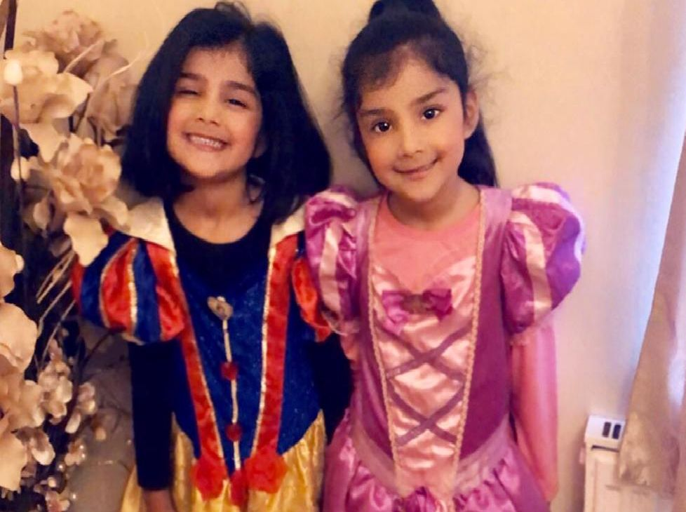 Twin sisters Malaikah and Medina, aged 4, pupils at St Leonards School Nursery, dressed as Snow White and Rapunzel.'.