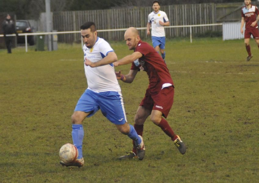 Little Common player-manager Russell Eldridge closes down a Newhaven opponent. Pictures by Simon Newstead