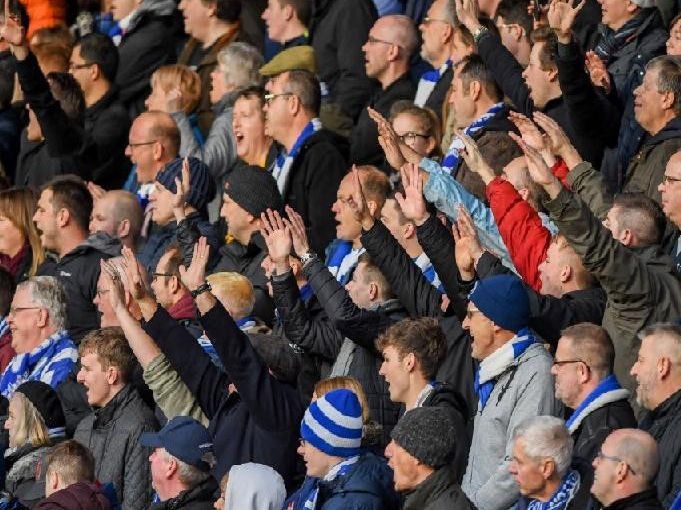 Albion fans watch on at the Vitality Stadium. Picture by PW Sporting Photography