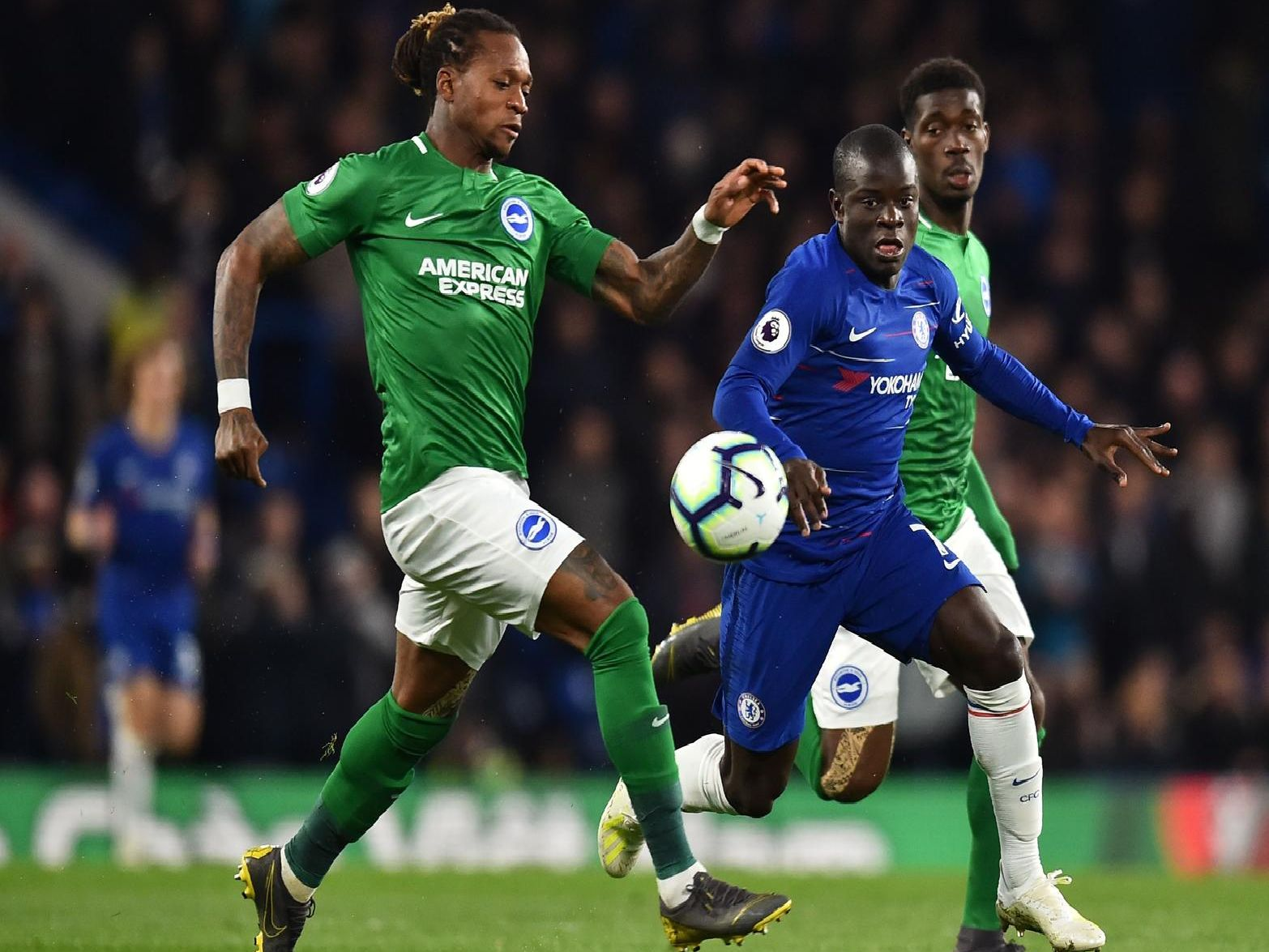 Brighton defender Gaetan Bong challenges N'Golo Kante. Picture by Getty Images