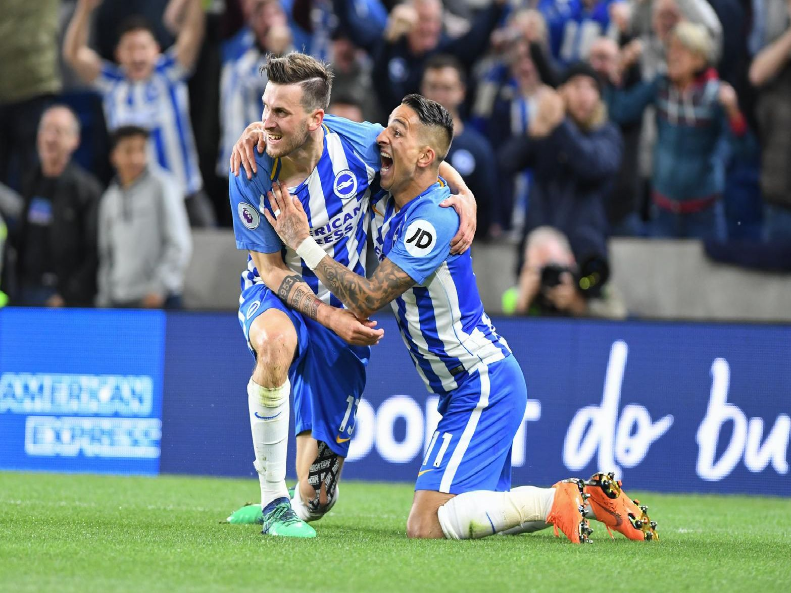 Two of Albion's past player-of-the-season winners Pascal Gross and Anthony Knockaert celebrate a goal.