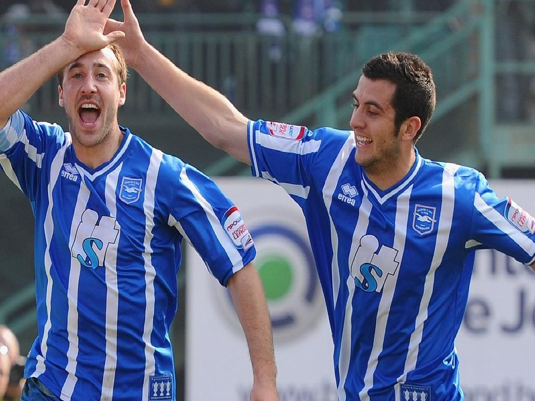 Glenn Murray and Gary Dicker celebrate a goal during the 2010/11 season. Picture by Getty Images