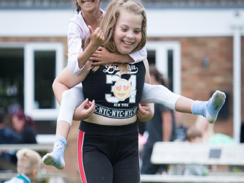 Winslow Big Society Summer Playscheme held at the recreation ground - pictured is Sophia Gibbard-Gill, eight, getting a piggyback from Remmini Jai-Rowlands, eight (dressed in black)
