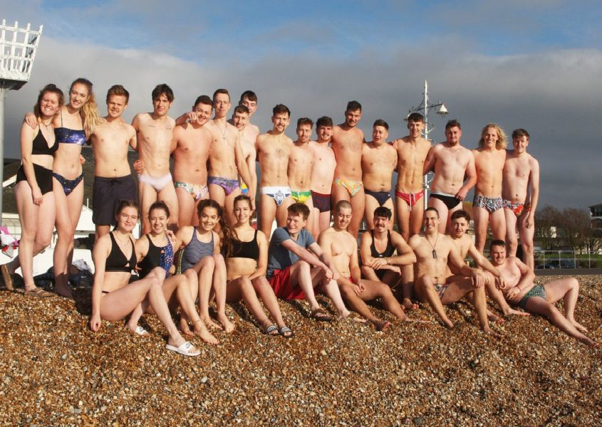 DM19112460a.jpg. Chichester University students take a dip in the sea for Movember. Photo by Derek Martin Photography. SUS-191124-162425008