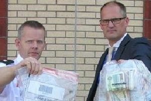 Pictured, left to right, Superintendent Jeremy Lindsay and Detective Inspector Blemmings with some of the items, including suspected drugs, seized in the Coleraine area on Thursday.