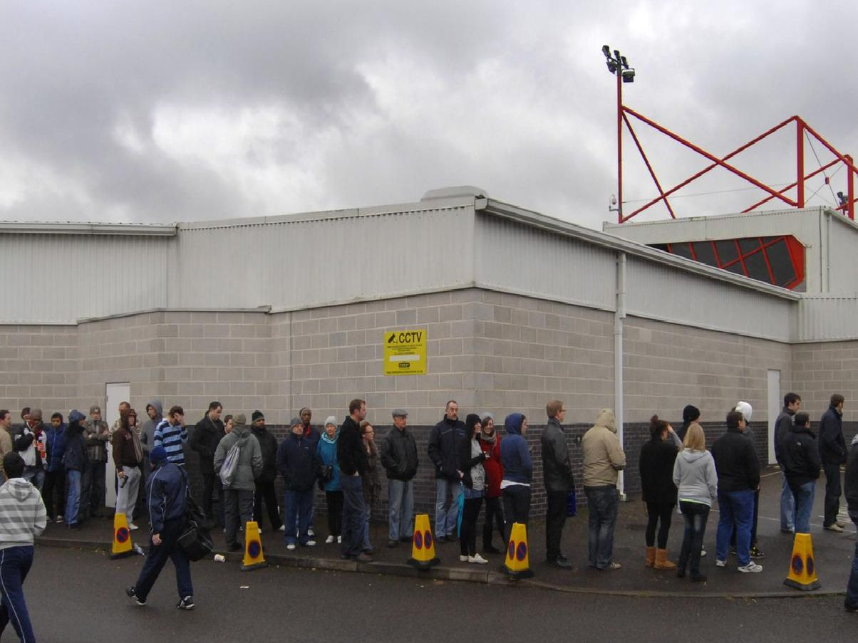 Crawley Town fans queue around the stadium