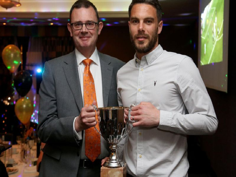 Glenn Morris lifts the Crawley Town Player of the Year award, presented by Roy Porter, director of sponsors The People's Pension.