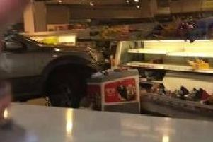 The car ploughed right into Sainsbury's in Crawley