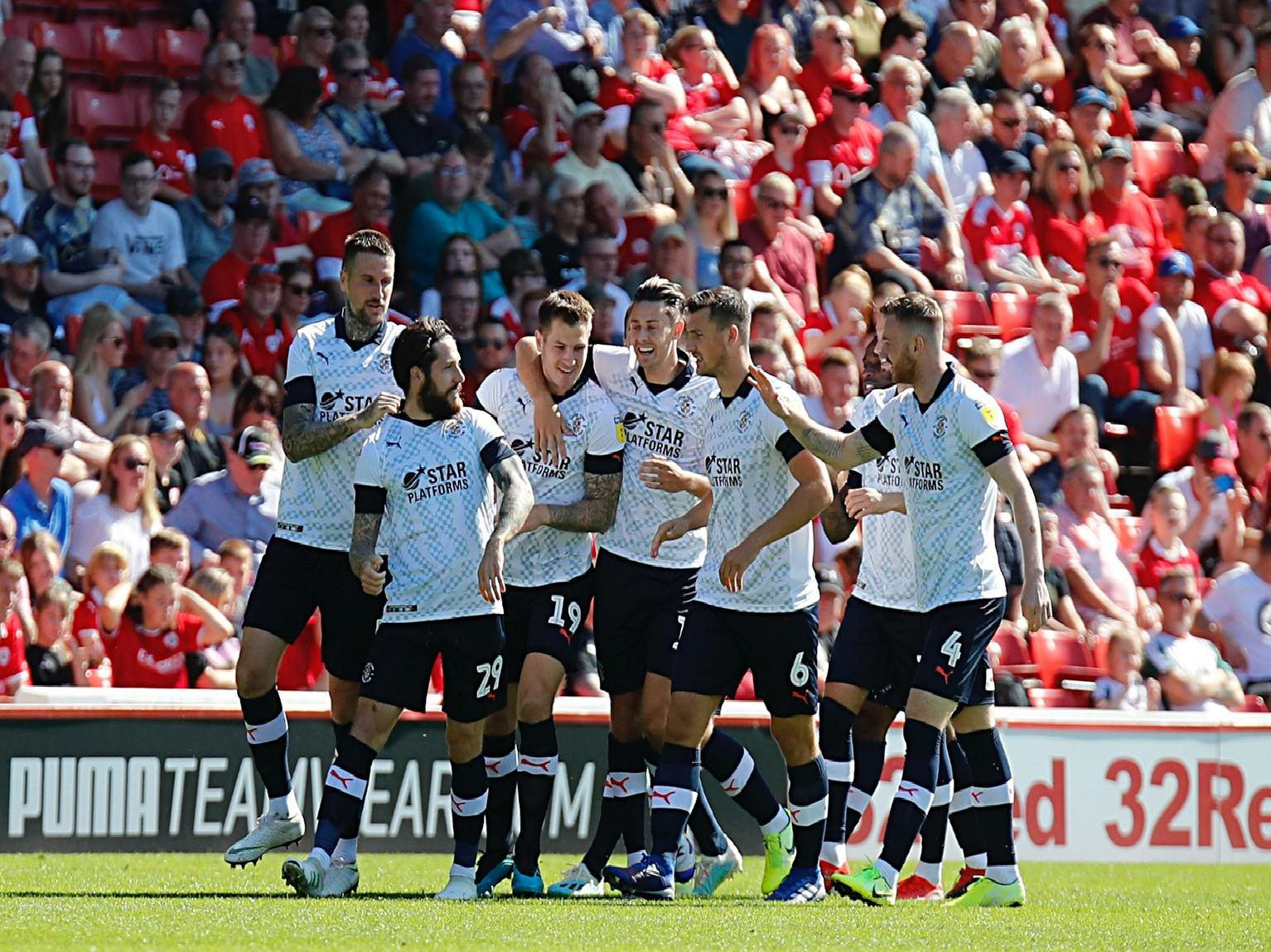 Luton celebrate opening Jacob Butterfield's goal in their opening win at Barnsley