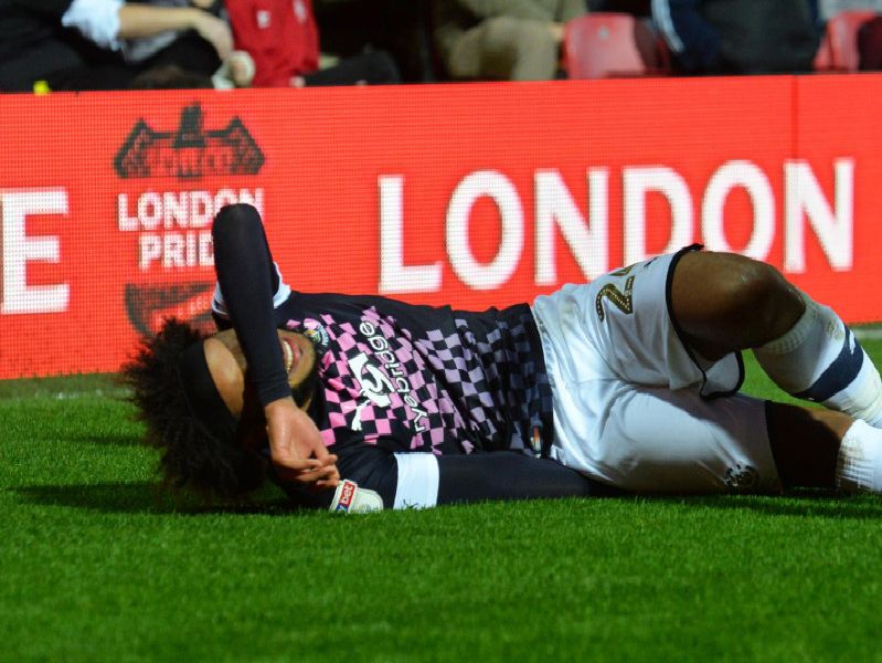 Izzy Brown suffers a hamstring injury during Luton's 7-0 thrashing at Brentford on Saturday