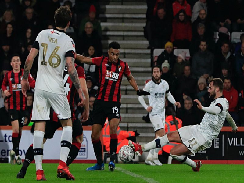 Andrew Shinnie tries to thread the ball through against Bournemouth
