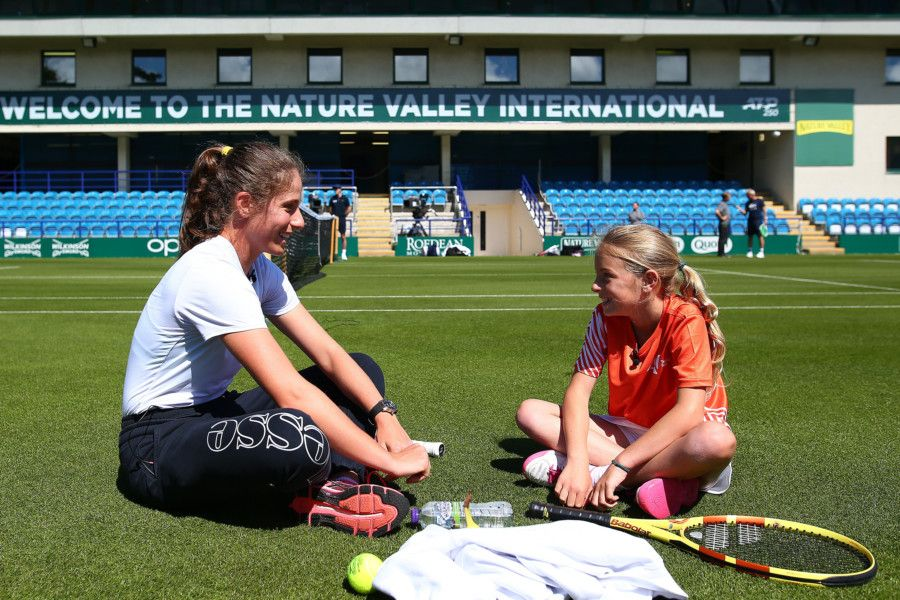 EASTBOURNE, ENGLAND - JUNE 21: Johanna Konta of Great Britain has a surprise hit on court with tennis for kids Ruby prior to the Nature Valley International at Devonshire Park on June 21, 2019 in Eastbourne, United Kingdom. (Photo by Charlie Crowhurst/Getty Images for LTA) *** Local Caption *** Johanna Konta SUS-190622-124523002