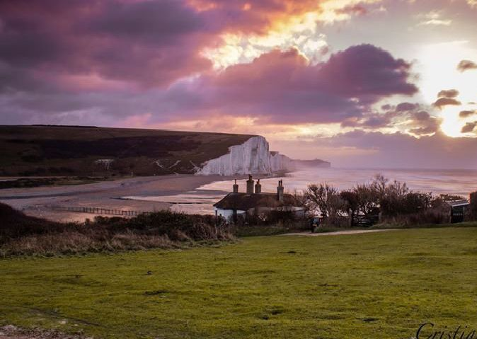 The classic Coastguard Cottages shot with the Cuckmere Haven and the Seven Sisters as a backdrop, taken by Christiano Oliveira. SUS-190829-101411001