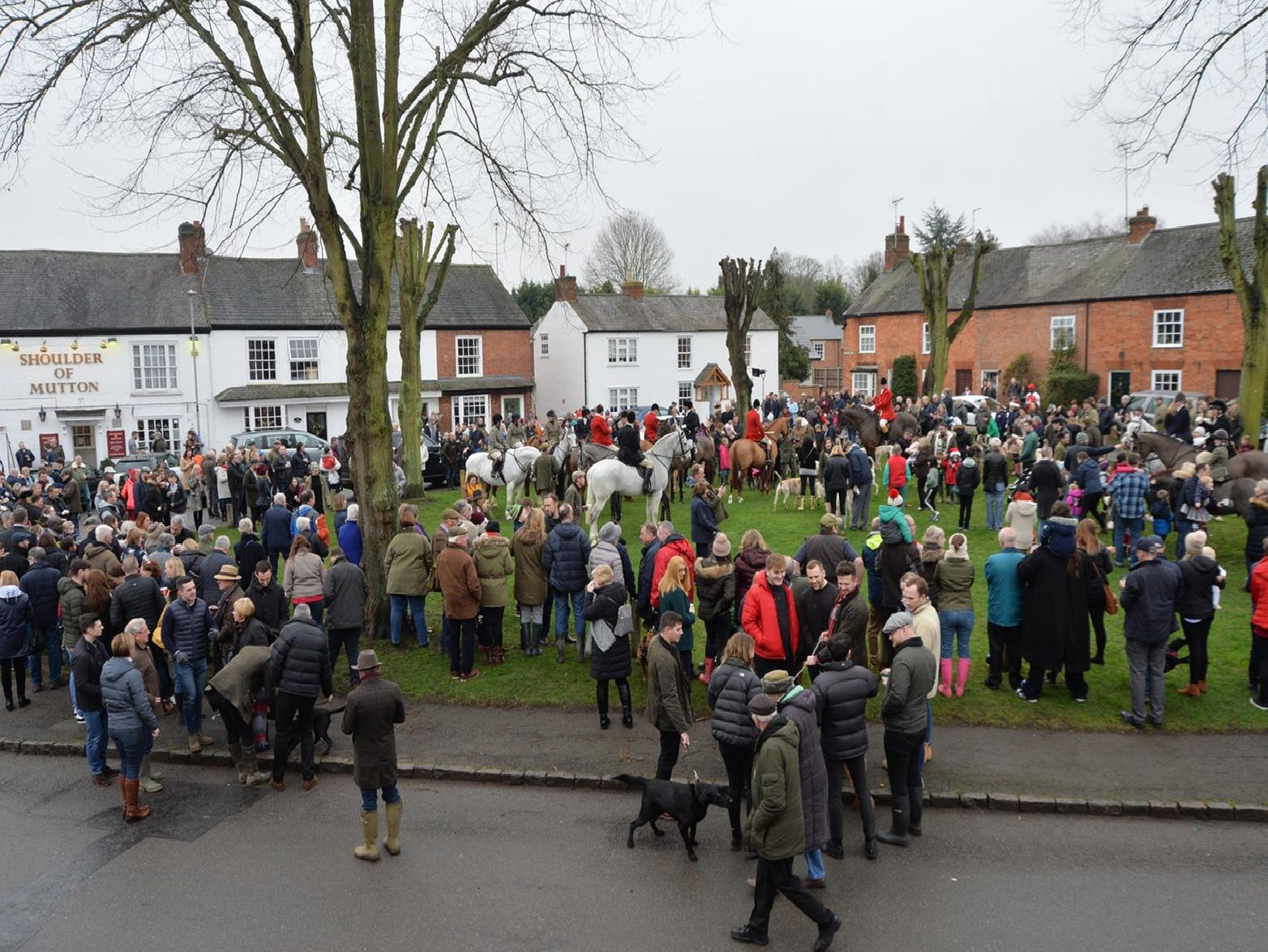 Crowds gather on the green in Great Bowden during the Fernie Boxing Day Hunt meet. PICTURE: ANDREW CARPENTER