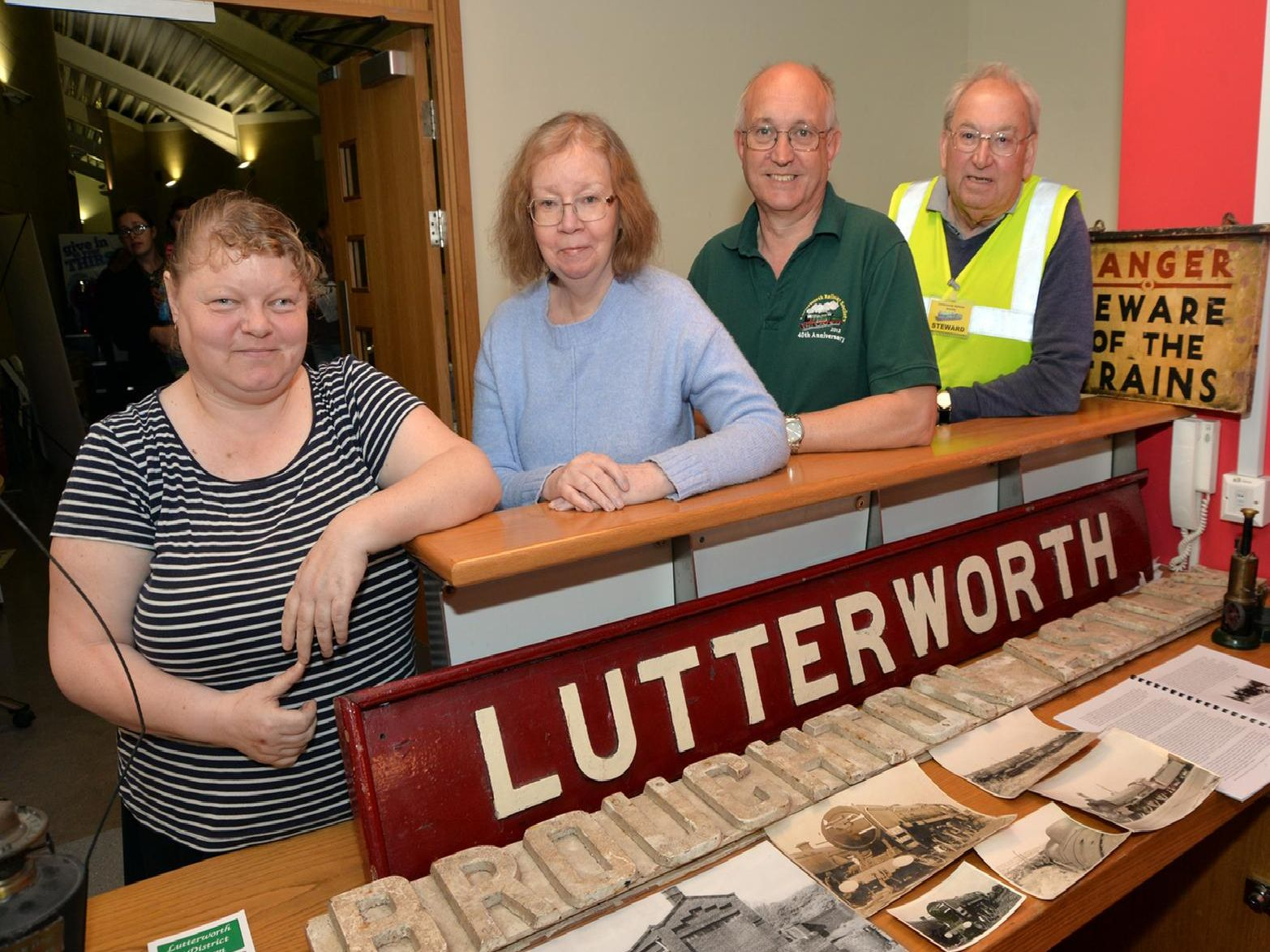 Kerry Girling and Alison Smith of Lutterworth Museum with David Hanger secretary of Lutterworth Railway Society and organiser Stuart Hammond with the original Lutterworth Railway Station sign. PICTURE: ANDREW CARPENTER