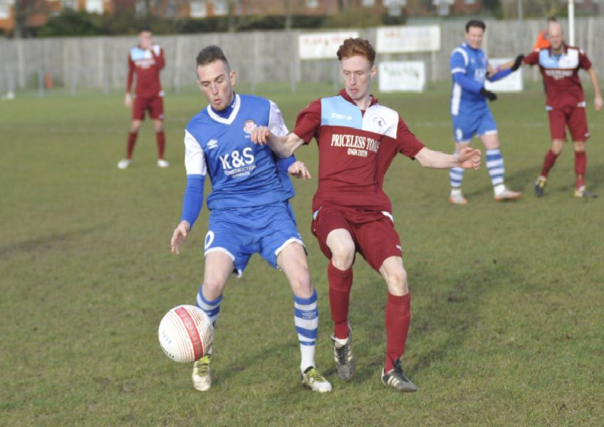 Little Common full-back Ollie Weeks keeps a close eye on Saltdean United forward Ryan Warwick