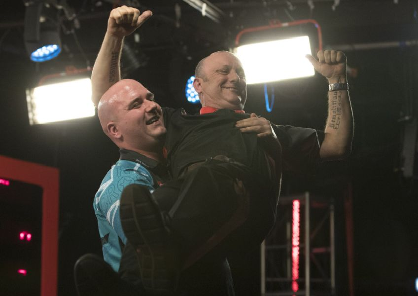 Rob Cross holds Darren Webster aloft LADBROKES UK OPEN 2019  BUTLINS RESORT  MINEHEAD  PIC LAWRENCE LUSTIG  ROUND 4  Rob CROSS V DARREN WEBSTER ROB CROSS holds Webster aloft after their fourth round match on Friday night