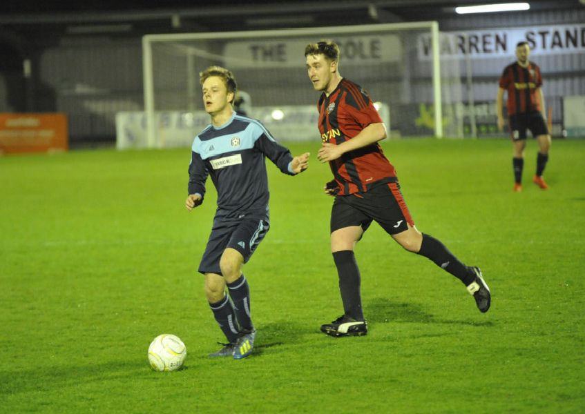 Action from the Wisdens Sports Challenge Cup final between South Coast Athletico (red and black kit) and Victoria Baptists