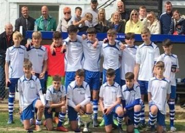 League Cup winners Tring Tornadoes Falcons under-14s with their trophy silverware and supporters at Marlow FC earlier this month.