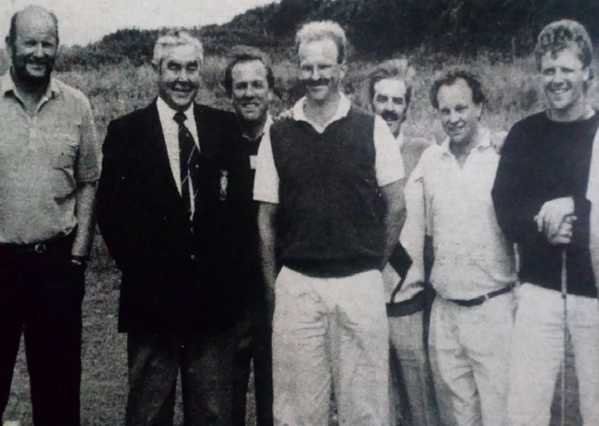 Captain of Larne Golf Club John Leitch with a group of his guests at the Club Captain's Day. 1989.