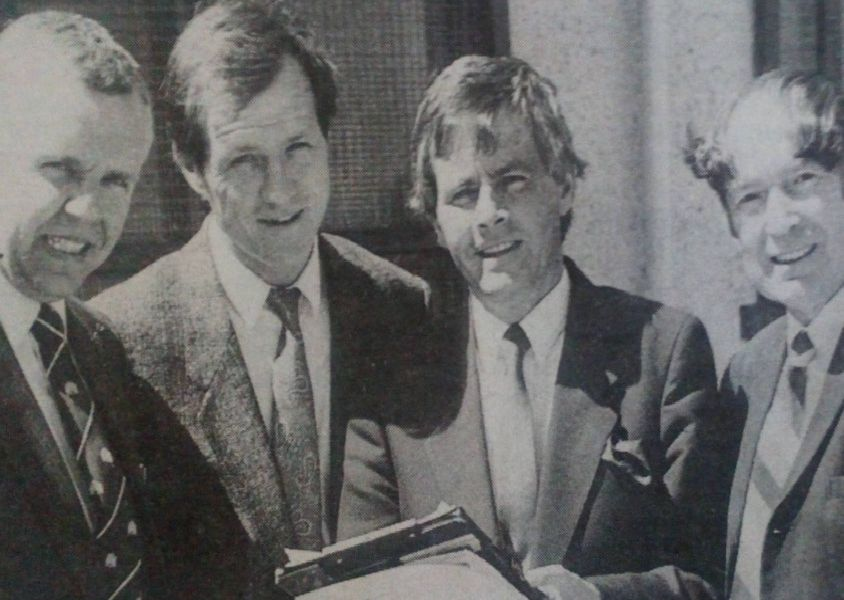 Tom Sloan (second left) discusses his plans for his testimonial match at Sandy Bay with Sgt. Tom Crawford of Larne RUC, Ronnie Blair of Larne Council, Victor Marcus of Larne Football Supporters' Club and Ian Chalmers, Larne Council. 1989.