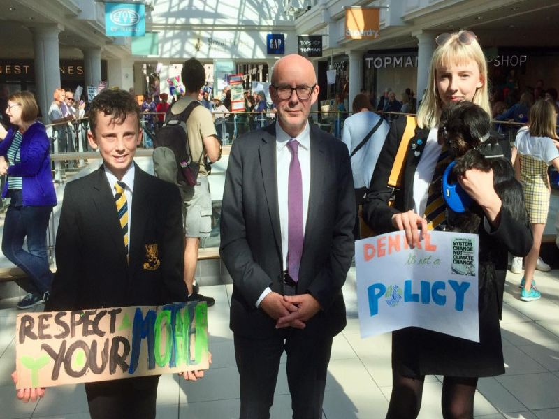 Finn Venn, aged 15, MP Matt Western and Finn's sister, 15-year-old Ella Venn, who attended the climate demonstration at the Royal Priors shopping Centre