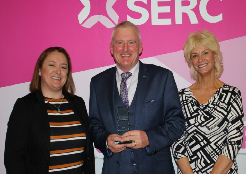 Robin Hamill - Aico - received an award for providing 'Support for SERC Students and Apprentices with Placements or Employment'. He is pictured with Karen Fraser, SERC Board of Governors and Guest Speaker Monica McCard from Lisburn