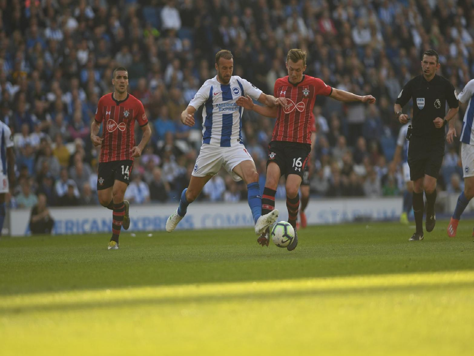 Glenn Murray battles for possession with James Ward-Prowse. Picture by PW Sporting Photography