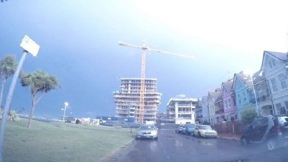 Lightning illuminates the Bayside apartments in Brighton Road