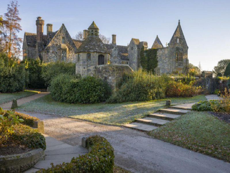 Nymans house in autumn (credit, National Trust _ Andrew Butler)