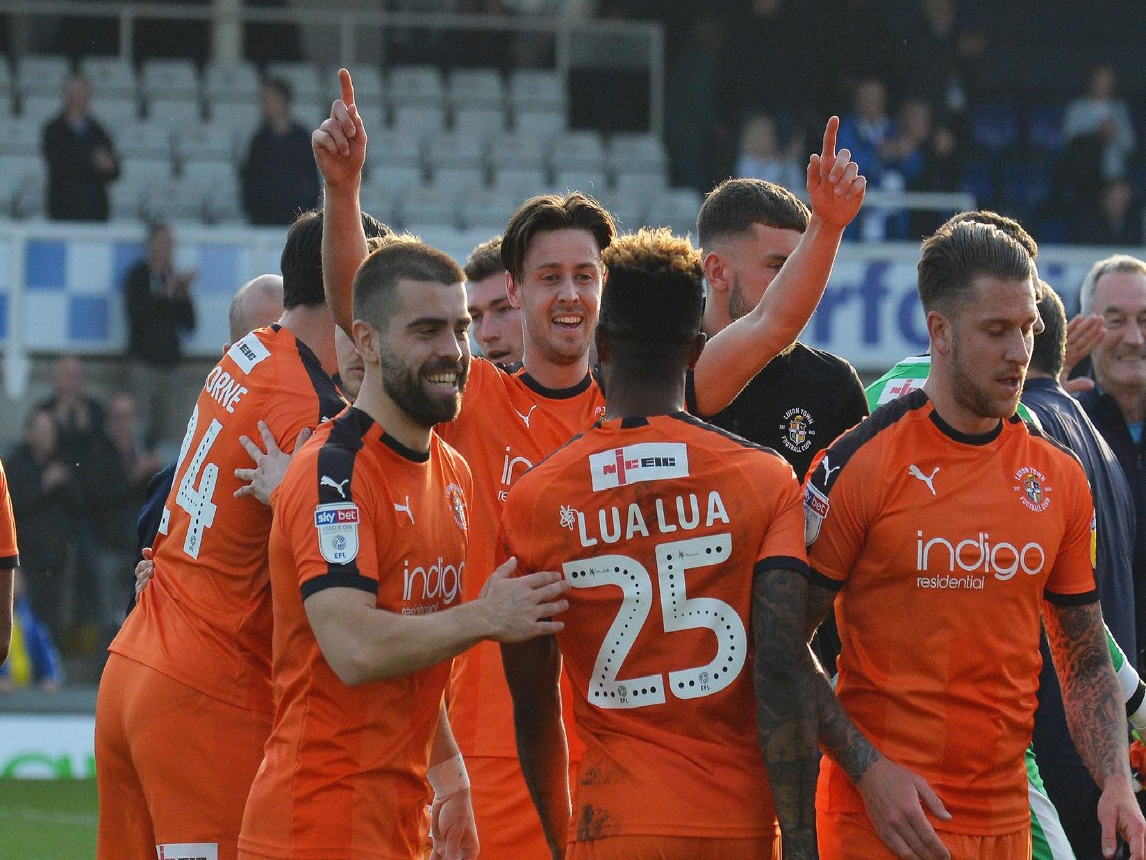 Town celebrate their 2-1 win at Bristol Rovers on Saturday