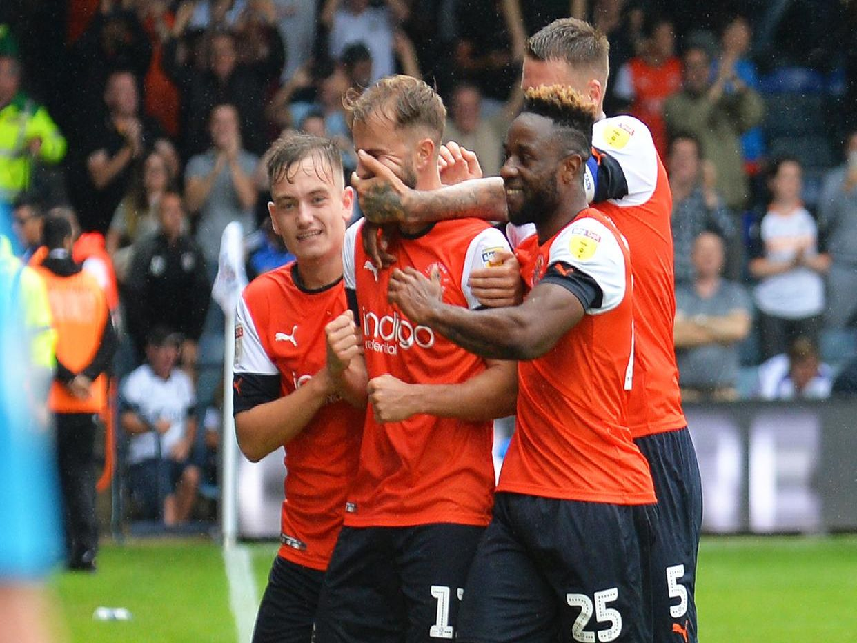 Luton celebrate Andrew Shinnie's winner against Huddersfield