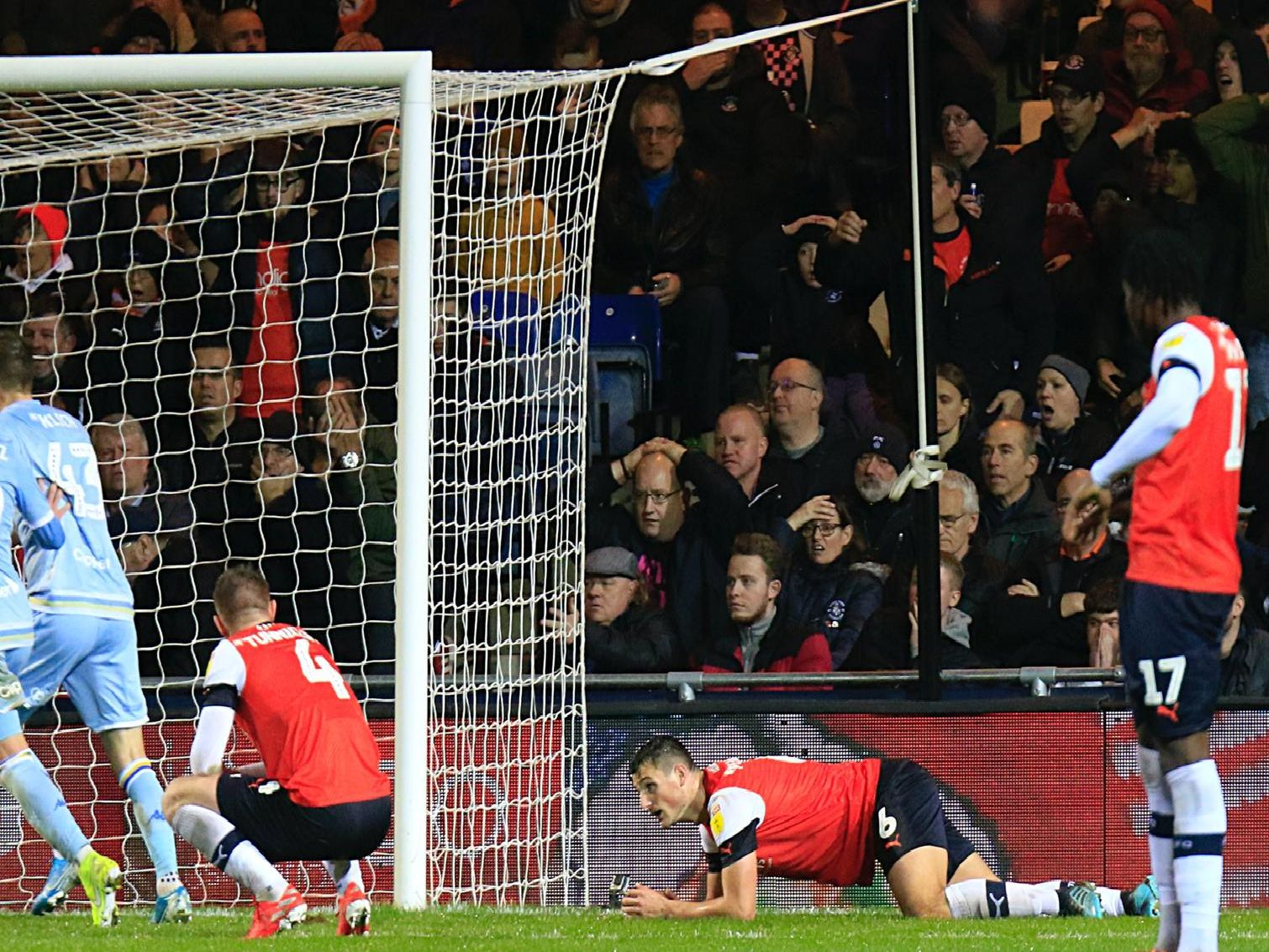 Luton's players drop to their knees after Leeds United score a late winner at Kenilworth Road