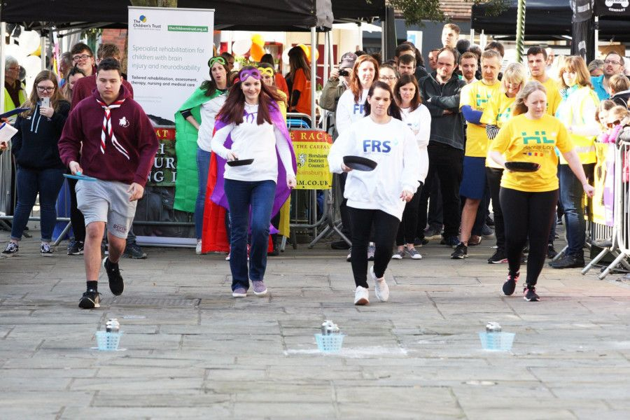 Horsham pancake races, 2019. Photo by Derek Martin Photography. SUS-190221-180112008