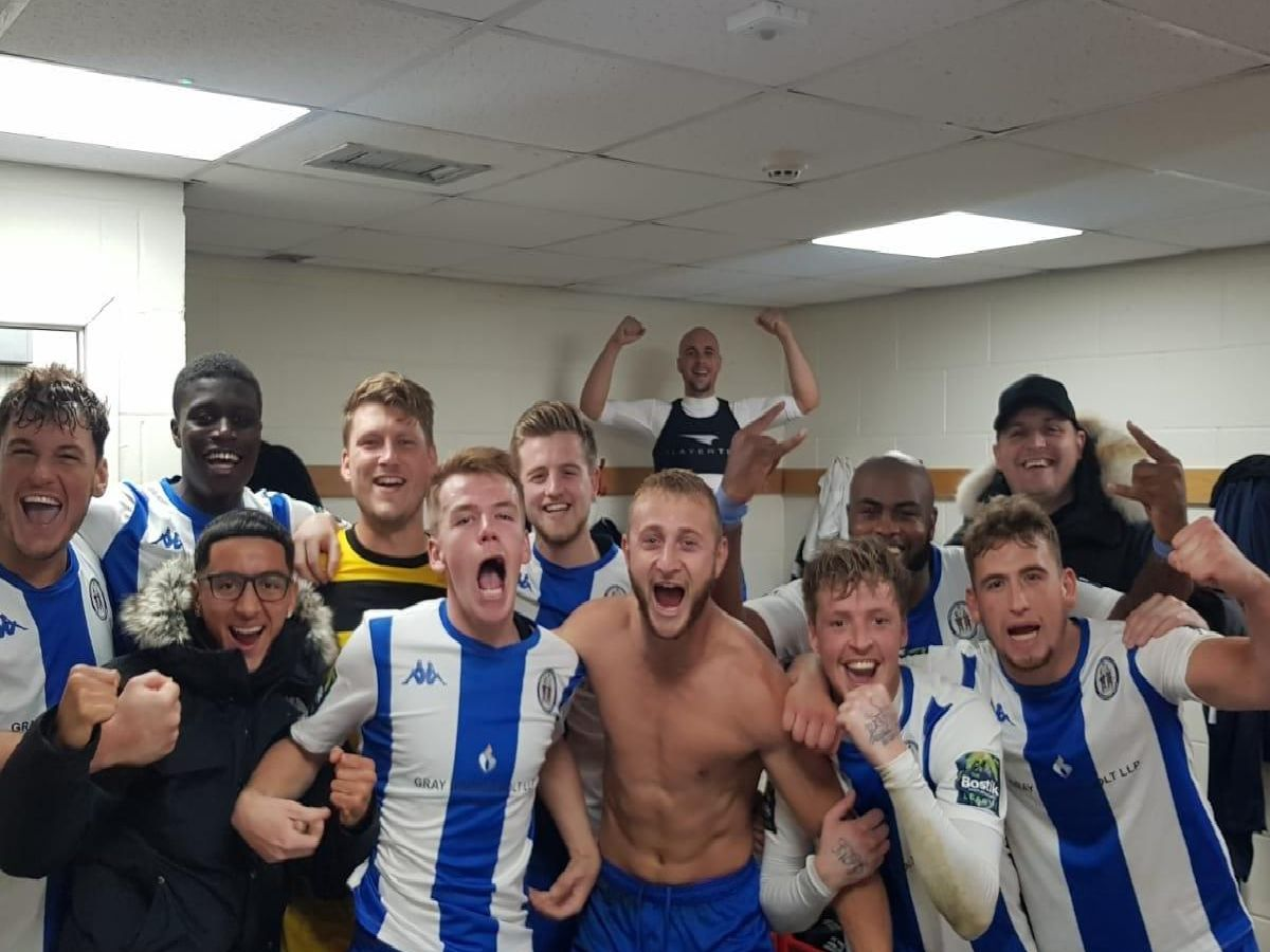 Haywards Heath Town players celebrate after beating Crawley Town. Picture by Roy Staughton