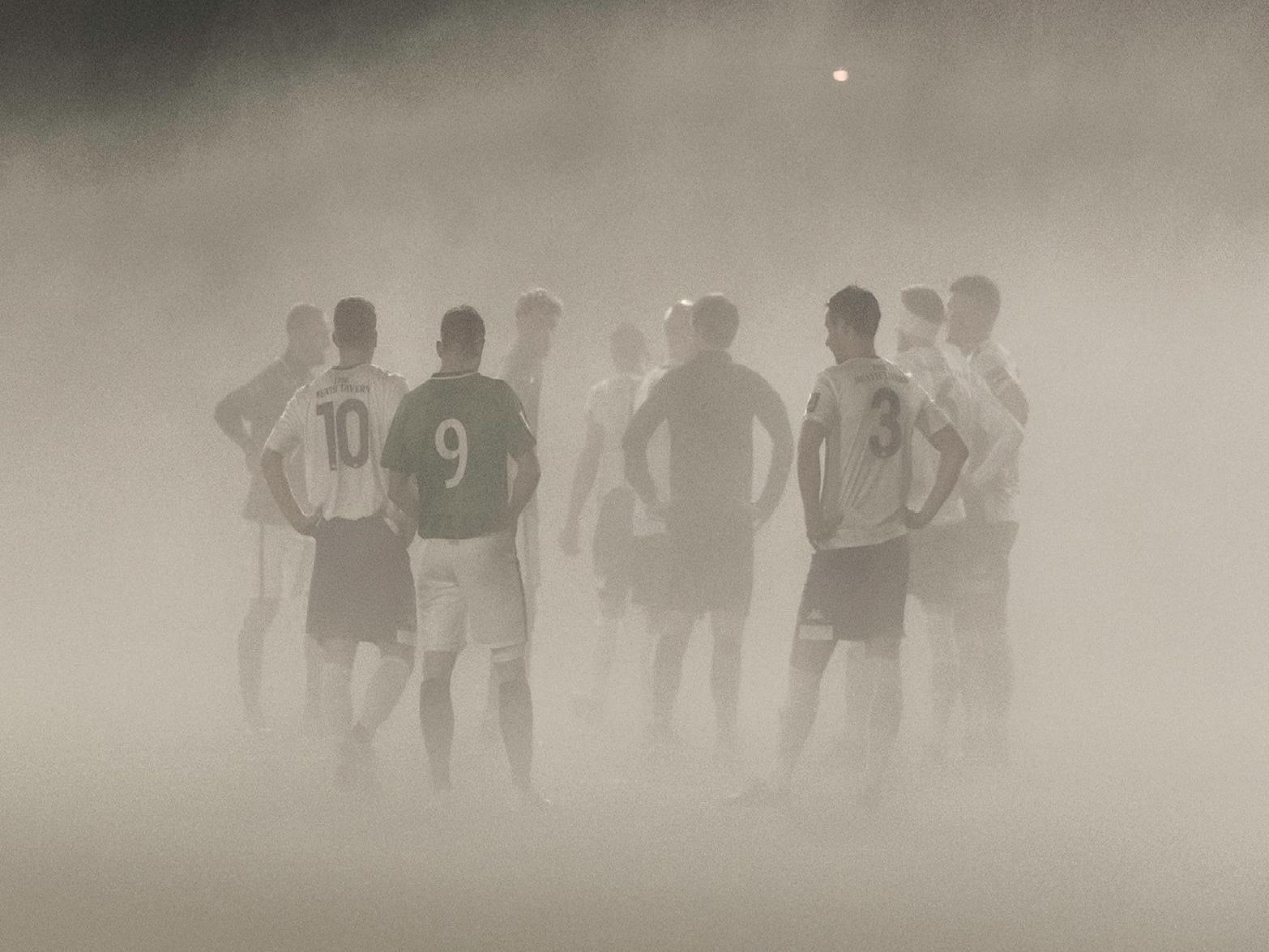 The players wait for the mist to clear. Chris Neal