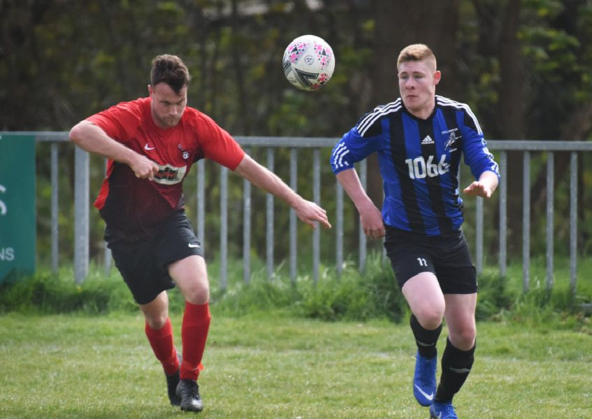 Hollington United and Cuckfield Rangers compete for a bouncing ball