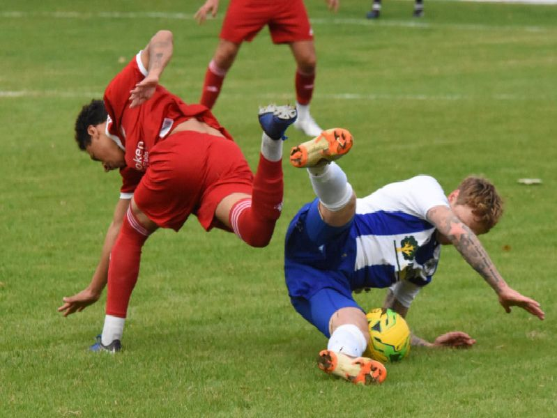 Callum Saunders is brought down.