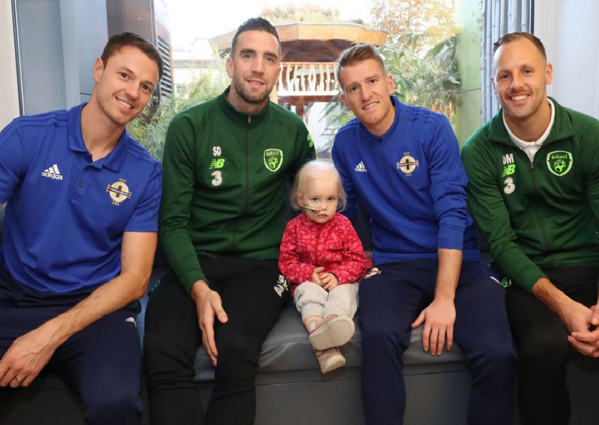 Players from the Northern Ireland and Republic of Ireland football squads came together today to visit Ireland's largest paediatric hospital, Our Lady's Children's Hospital in Dublin, to support children with cancer and to highlight the work of medical and caring staff who help to fight the disease.'Northern Ireland's Steven Davis and Jonny Evans with Republic of Ireland's Shane Duffy and David Meyler visited 2 year old Ellen Meehan at Ireland's largest paediatric hospital, Our Lady's Children's�Hospital�Crumlin, to encourage young people who have cancer and to highlight the work of medical and caring staff who help to fight the disease.