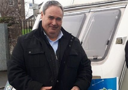 Sinn Fein MLA Colum Eastwood beside the caravan he used for a political clinic in Moy on Saturday 26 January.