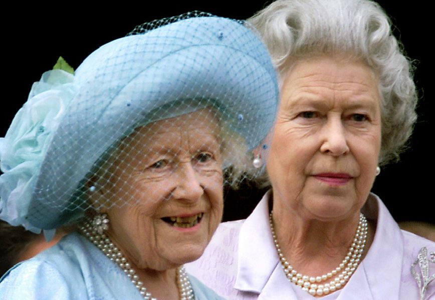 Queen Elizabeth (L), the Queen Mother celebrates her 100th birthday from the balcony of Buckingham Palace with her daughter Queen Elizabeth II, as thousands of people flocked to the streets outside the Palace to cheer the Queen Mother.