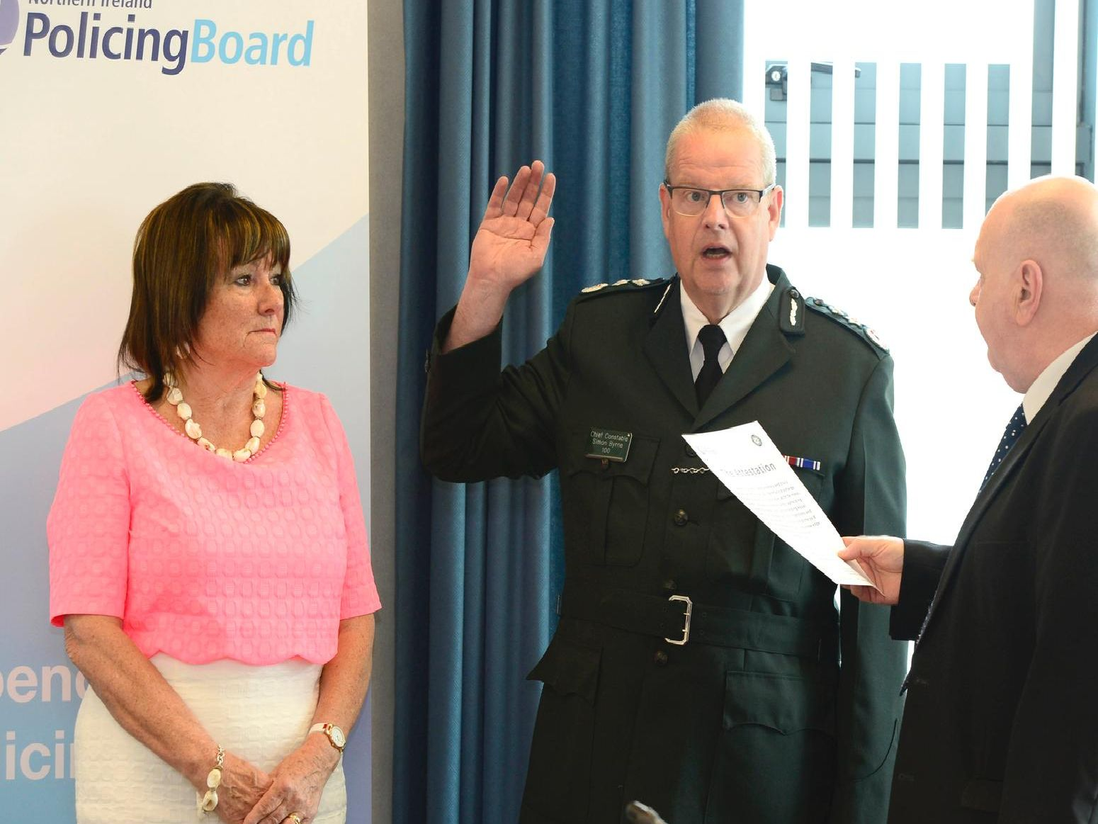 Simon Byrne has officially taken over as the chief constable of the Police Service of Northern Ireland (PSNI) on a five-year contract. Included are Policing Board Chair Anne Connolly and Prof David A Flynn Justice of the Peace.