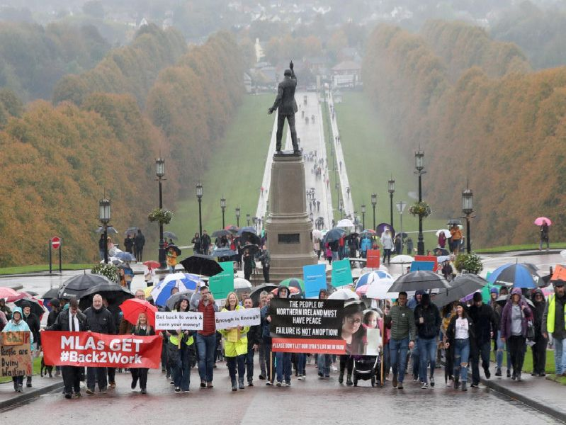 A protest has taken place at Stormont organised by the campaign group We Deserve Better to mark 1,000 days since the collapse of the Assembly