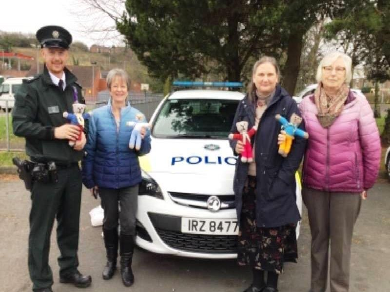 Antrim and Newtownabbey PSNI taking receipt of a second batch of Trauma Teddies from crafting group, Easy Come, Easy Sew.