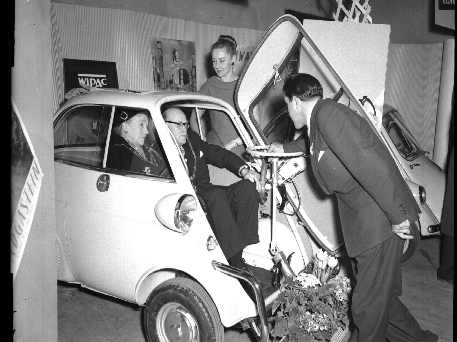 Trying a bubble car for size at the motorcycle and microcar show at Northampton Guildhall, March 14, 1959