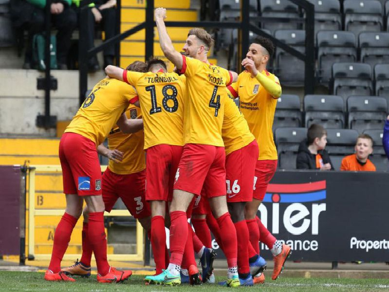 TURNAROUND! Cobblers celebrate after Sam Hoskins' deflected free-kick puts them 2-1 ahead at Meadow Lane.
