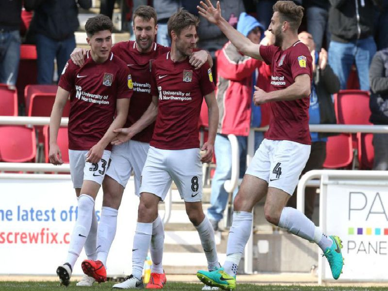SAM'S THE MAN! Midfielder Sam Foley receives the plaudits after heading the Cobblers level against Mansfield on Saturday.