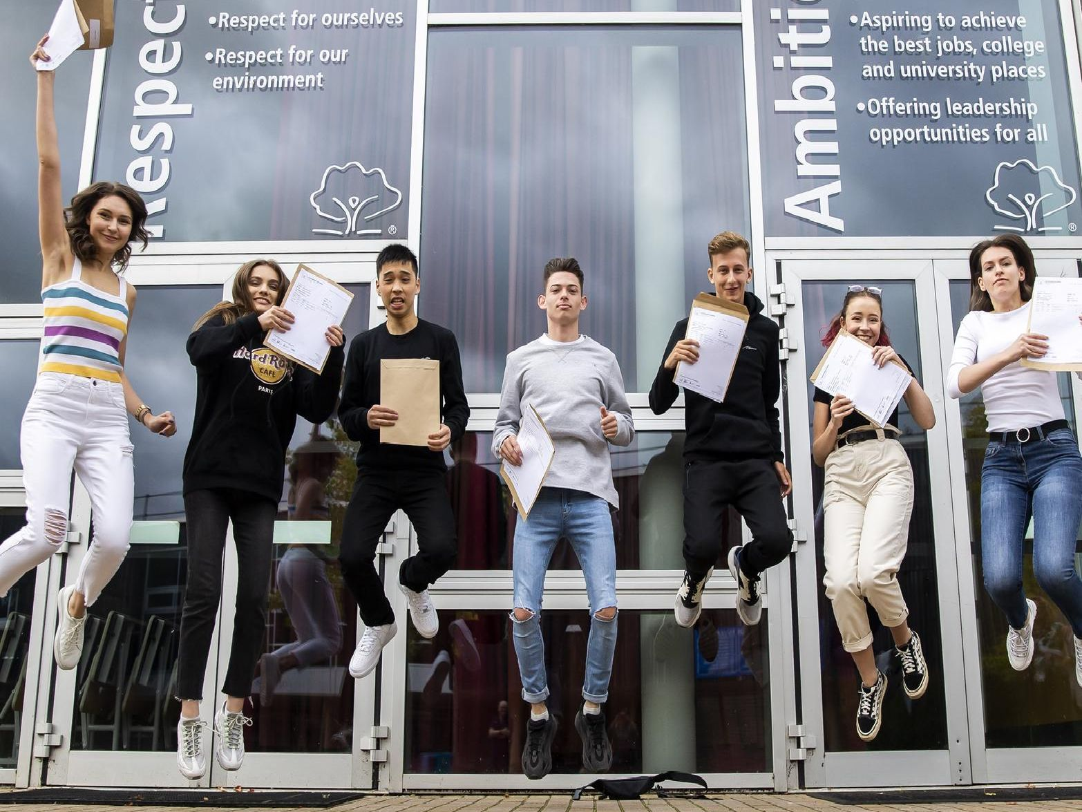 Jumping for joy at Northampton Academy. (L-R) Catalina Creanga, Patricia Vulc, Phillip Ung, Kieran Mason, Tom Walding, Isabelle Hannon-Thompson and Catalina Agachi